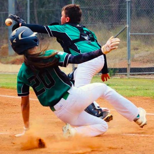Baseballer sneaking into homeplate